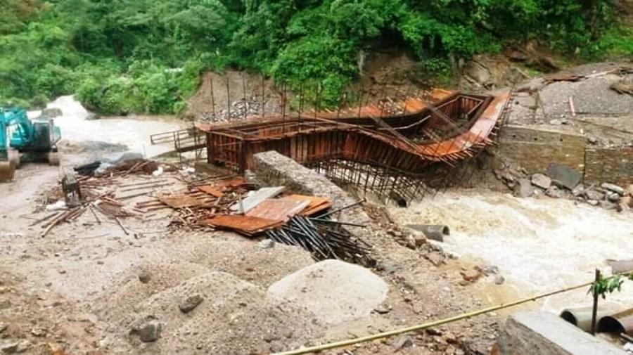 Flood takes away under construction bridge
